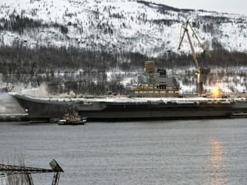 Russian 'ship of shame' aircraft carrier, used in Syria war, burning in port
