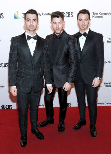 From left to right: Joe Jonas, Nick Jonas and Kevin Jonas of The Jonas Brothers attend the 42nd Annual Kennedy Center Honors Kennedy Center on December 08, 2019 in Washington, DC. - Paul Morigi/Getty Images North America/TNS