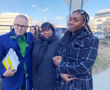 Jazmine Headley, right, her mother and her attorney, Brian Neary, are pictured after leaving the Mercer County Courthouse in New Jersey. Headley received a $625,000 settlement from the city. - Esha Ray/New York Daily News/TNS