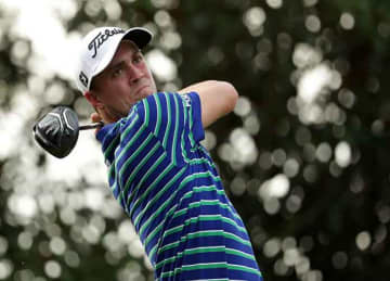 Golfer Justin Thomas of the United States plays his shot