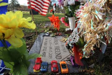 "Colorful toy cars, superhero figures, toys, flowers and flags adorn the gravestone of 5-year-old Andrew ""AJ"" Freund at St. Michael the Archangel Catholic Cemetery and Mausoleum on Dec. 5, 2019 in Palatine. - Stacey Wescott/Chicago Tribune/TNS"