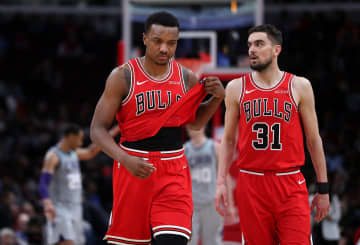 The Chicago Bulls' Wendell Carter Jr. (34) and Tomas Satoransky (31) walk off the floor after an 83-73 loss to the Charlotte Hornets at the United Center in Chicago on Friday, Dec. 13, 2019. - Chris Sweda/Chicago Tribune/TNS