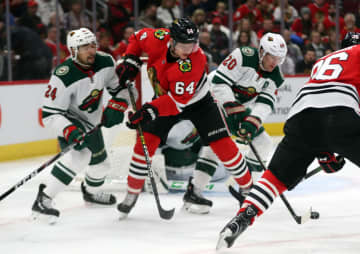Chicago Blackhawks center David Kampf (64) looks for the puck against the Minnesota Wild in the first period Sunday, Dec. 15, 2019 at the United Center in Chicago, IL. - Brian Cassella/Chicago Tribune/TNS