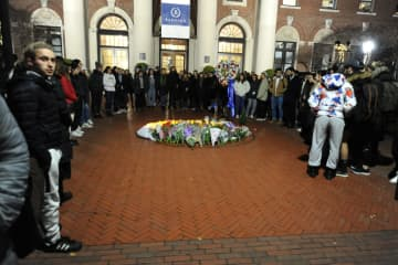 People gather at a memorial for Tessa Majors inside the Barnard campus on Dec. 12, 2019 in New York, N.Y. - Sam Costanza/New York Daily News/TNS
