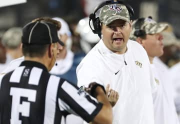 UCF head coach Josh Heupel talks to an official on the sidelines against Connecticut at Spectrum Stadium in Orlando, Fla., on September 2, 2019. - Stephen M. Dowell/Orlando Sentinel/TNS