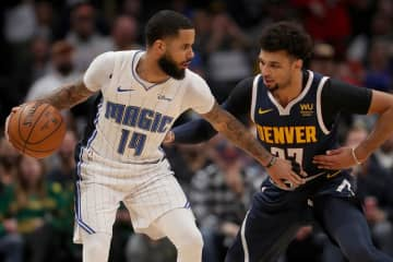 The Orlando Magic's D.J. Augustin (14) works against the Denver Nuggets' Jamal Murray (27) in the fourth quarter at the Pepsi Center in Denver on Wednesday, Dec. 18, 2019. - Matthew Stockman/Getty Images North America/TNS