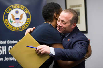 U.S. Rep. Josh Gottheimer (D-NJ) hugs Opeyemi Sowore, a Hawthorne resident and 5th District constituent whose husband, Omoyele Sowore, is being detained in his native Nigeria. (Steve Hockstein/)