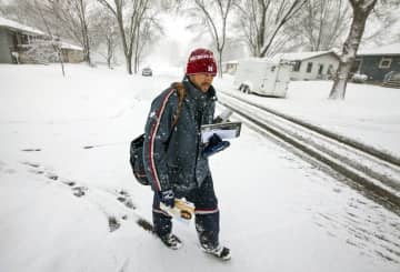 Don't forget a tip for your mail carrier. (Andrew Link/The Rochester Post-Bulletin via AP) (AP Photo/)