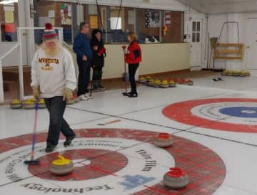 Larry Barott, in foreground, tended the house at the Heather Curling Club in Mapleton, Minn., which claims to be the birthplace of Minnesota curling. - Star Tribune/Star Tribune/JOHN REINAN    Star Tribune/Star Tribune/TNS
