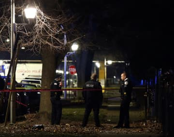 Chicago police guard a crime scene in the 5700 block of South May Street in Chicago after several people were shot there on Sunday, Dec. 22, 2019. - Terrence Antonio James/Chicago Tribune/TNS