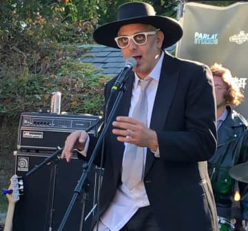 """Dancing Tony'' Susco emcees the Ghost of Uncle Joe's show at the Historic Jersey City & Harsimus Cemetery. (Jim Testa/)"