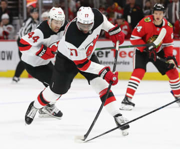 Wayne Simmonds #17 of the New Jersey Devils tries to get off a shot against the Chicago Blackhawks at the United Center on Dec. 23, 2019 in Chicago. The Devils won, 7-1. - Jonathan Daniel/Getty Images North America/TNS