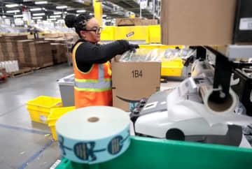 Ty Thompson packs orders at Amazon's West Deptford fulfillment center, Friday, Feb. 1, 2019. (Tim Hawk | NJ Advance Media for NJ.com) (Tim Hawk/)