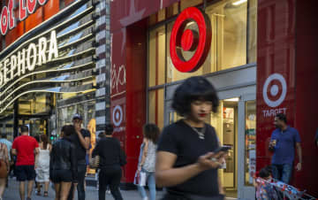 Shoppers outside a Target store in Herald Square in New York on Tuesday, August 20, 2019. Consumers return more items during and after the holiday shopping season than at any other time of the year. - Richard B. Levine/Sipa USA/TNS
