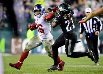 New York Giants running back Saquon Barkley (26) stiff-arms Philadelphia Eagles cornerback Ronald Darby (21) at Lincoln Financial Field in Philadelphia on December 9, 2019. - Emilee Chinn/Getty Images North America/TNS