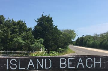 A sign for Island Beach State Park along Shore Road, the park's only thoroughfare. (Steve Strunsky/)