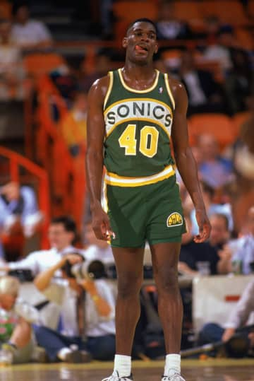 Shawn Kemp (40) of the Seattle Supersonics stands on the court in a game against the Los Angeles Lakers during the 1989-1990 NBA season at the Great Western Forum in Los Angeles, Calif. - Ken Levine/Getty Images North America/Getty Images