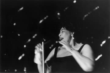 Jazz singer Ella Fitzgerald on stage at the Hammersmith Odeon, London on Feb. 26, 1963. - Ronald Dumont/Express/Hulton Arc/Getty Images North America/TNS