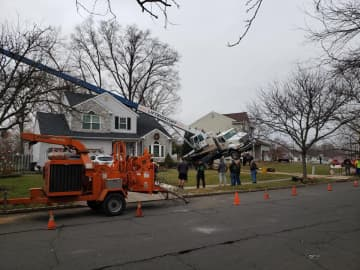 A crane fell onto a house in Hamilton Friday. (Photo courtesy Hamilton Police Department) (Hamilton Township Police Department/)