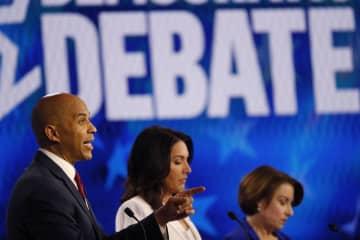 Sen. Cory Booker, D-N.J., left, speaks as Rep. Tulsi Gabbard, D-Hawaii, and Sen. Amy Klobuchar, D-Minn., right, listen during the Democratic presidential primary debate on Nov. 20, 2019, in Atlanta. (John Bazemore/)