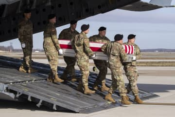 An Army carry team moves a transfer case containing the remains of U.S. Army Sgt. 1st Class Michael Goble at Dover Air Force Base, Del. (Alex Brandon/)