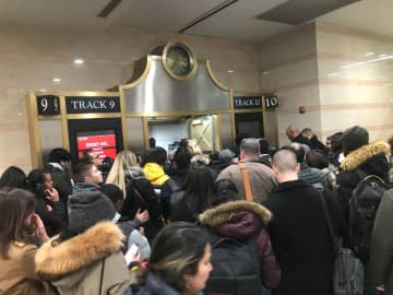 Commuters in Penn Station New York crowd a stairway after the track was posted for their NJ Transit Northeast Corridor Line train on Dec. 18. Those interviewed said they've seen little improvement in service this year. (Larry Higgs/)