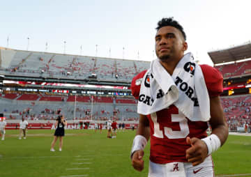 In this file image, Tua Tagovailoa (13) of the Alabama Crimson Tide runs off the field after their 59-31 win over the Mississippi Rebels at Bryant-Denny Stadium on September 28, 2019 in Tuscaloosa, AL. - Kevin C. Cox/Getty Images North America/TNS