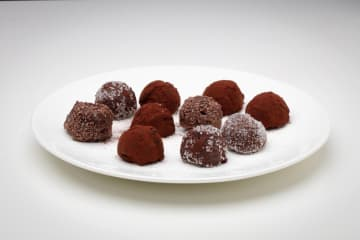 Roll the truffles in the coating of your choice, maybe cocoa powder, granulated sugar, sprinkles or nuts. - E. Jason Wambsgans/Chicago Tribune/TNS
