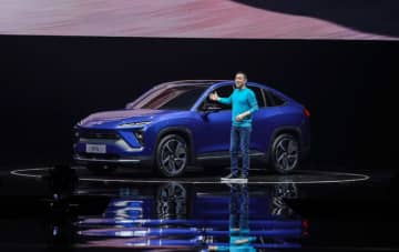 William Li Bin, founder and CEO of Nio unveiled the electric coupe SUV model EC6, with a claimed NEDC range of 615 km at its annual launch event Nio Day in Shenzhen on Saturday, December 28, 2019. (Image credit: Nio)