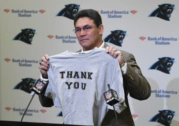 Former Panthers head coach Ron Rivera holds up a T-shirt at the end of a press conference at Bank of America Stadium on Dec. 4, 2019. - David T. Foster III/Chicago Tribune/TNS