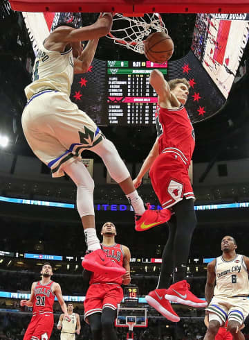 Giannis Antetokounmpo #34 of the Milwaukee Bucks dunks against Lauri Markkanen #24 of the Chicago Bulls at the United Center on Dec. 30, 2019 in Chicago. The Bucks won, 123-102. - Jonathan Daniel/Getty Images North America/TNS