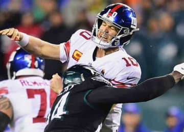 PHILADELPHIA, PENNSYLVANIA - DECEMBER 09: Quarterback Eli Manning #10 of the New York Giants is tackled by defensive end Josh Sweat #94 of the Philadelphia Eagles during the game at Lincoln Financial Field on December 09, 2019 in Philadelphia,...