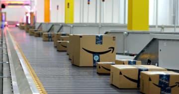 Boxes roll down the conveyor inside the Amazon Fulfillment Center on Tuckaseegee Road in Charlotte. - JOHN CLARK/Gaston Gazette/TNS