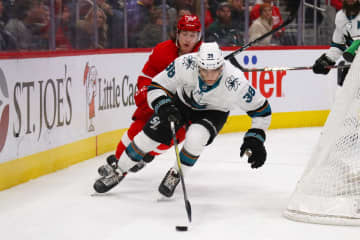 The San Jose Sharks' Mario Ferraro (38) carries the puck in front of Tyler Bertuzzi of the Detroit Red Wings during the second period at Little Caesars Arena in Detroit on Tuesday, Dec. 31, 2019. - Gregory Shamus/Getty Images North America/TNS