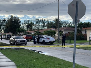 Miami police at the scene of a fatal fire that claimed the lives of three children on December 30, 2019. - Alex Harris/Miami Herald/TNS