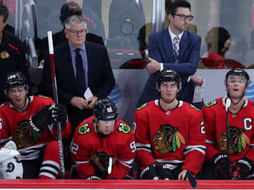 Blackhawks assistant Marc Crawford, left, stands behind the bench beside coach Jeremy Colliton during a game against the Lightning on Nov. 21, 2019 at the United Center in Chicago, Ill. - Chris Sweda/Chicago Tribune/TNS