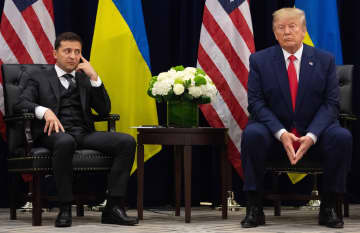President Donald Trump, right, with Ukrainian President Volodymyr Zelensky during a meeting in New York on September 25, 2019, on the sidelines of the United Nations General Assembly. - SAUL LOEB/AFP/Getty Images North America/TNS