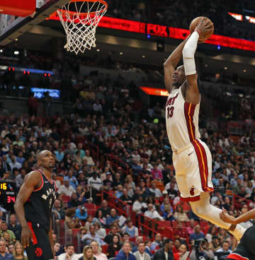 The Miami Heat's Bam Adebayo (13) dunks against the Toronto Raptors in the second quarter at the AmericanAirlines Arena in Miami on Thursday, Jan. 2, 2020. - DAVID SANTIAGO/Miami Herald/TNS