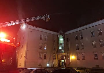 A fire in an apartment building in Bayonne left one person dead, one critically injured and others unaccounted for, officials said. (Bayonne OEM/)