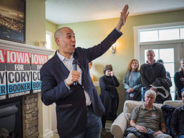 Sen. Cory Booker (D-N.J.) talks to guests at a campaign house party in Ankeny, Iowa, on December 31, 2019. - Jack Kurtz/Zuma Press/TNS