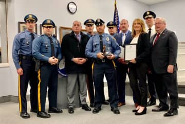 Officer Justin Walker receives the Officer of the Year Award from the Washington Township Police Department. (Courtesy of the WTPD/)
