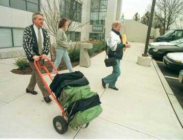 Phil Cerria (left), who was serving as Woodbridge's municipal clerk at the time of this 1996 file photo, brings voter registration books to a car. (Star-Ledger file photo/)