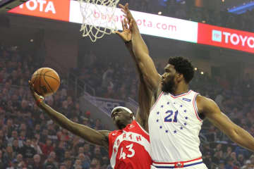The Philadelphia 76ers' Joel Embiid (21) fouls the Toronto Raptors' Pascal Siakam on May 5, 2019, at the Wells Fargo Center in Philadelphia during Game 4 of the Eastern Conference semifinals. - CHARLES FOX/The Philadelphia Inquirer/TNS