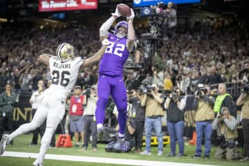 Minnesota Vikings tight end Kyle Rudolph catches the winning touchdown over New Orleans Saints cornerback P.J. Williams in overtime on Sunday, Jan. 5, 2020 at Mercedes-Benz Superdome in New Orleans, La. - Elizabeth Flores/Minneapolis Star Tribune/TNS