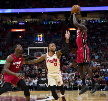 Miami Heat guard Kendrick Nunn (25) shoots over Portland Trail Blazers point guard Damian Lillard (0) during the first quarter on Sunday, Jan. 5, 2019 at American Airlines Arena in Miami, Fla. - Daniel A. Varela/Miami Herald/TNS