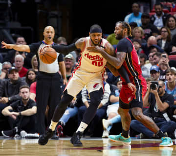 Miami Heat power forward James Johnson (16) guards Portland Trail Blazers power forward Carmelo Anthony (00) during the second quarter on Sunday, Jan. 5, 2019 at American Airlines Arena in Miami, Fla. - Daniel A. Varela/Miami Herald/TNS