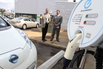 State Assembly Majority Leader Lou Greenwald (left) and Jeff Tittel, Director of the New Jersey Sierra Club, discuss the benefits of electric vehicles in 2012 at the Cherry Hill Nissan Dealership. (Tim Hawk/)