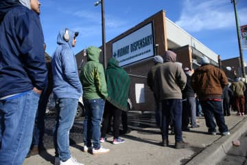 On the second day of legal recreational cannabis sales, people line up outside the Midway Dispensary in Chicago, on Jan. 2, 2020. - Antonio Perez/Chicago Tribune/TNS