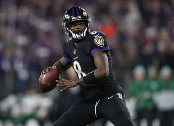 BALTIMORE, MARYLAND - DECEMBER 12: Quarterback Lamar Jackson #8 of the Baltimore Ravens passes the ball against the New York Jets at M&T Bank Stadium on December 12, 2019 in Baltimore, Maryland.