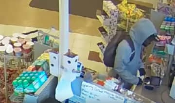 A still from the surveillance footage of a robbery of a West Oak Lane Rite Aide, during which the suspect claimed he had a sick child. - Philadelphia Police Department/TNS/TNS